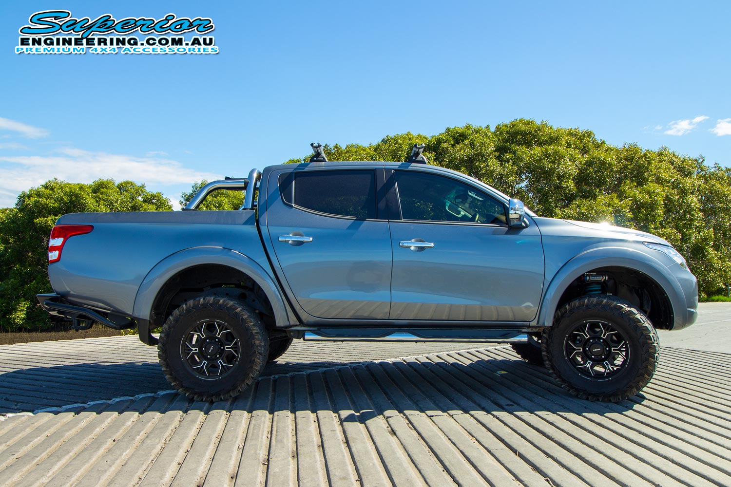 Right view of a MQ Mitsubishi Triton fitted with some Premium Superior Remote Reservoir Shocks and Struts at the Caboolture river boat ramp