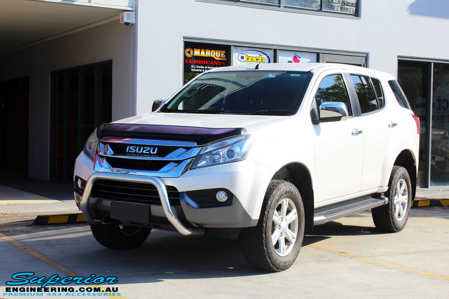 Left front side view of a White Isuzu MU-X Wagon after fitment of a quality Bilstein 45mm Lift Kit