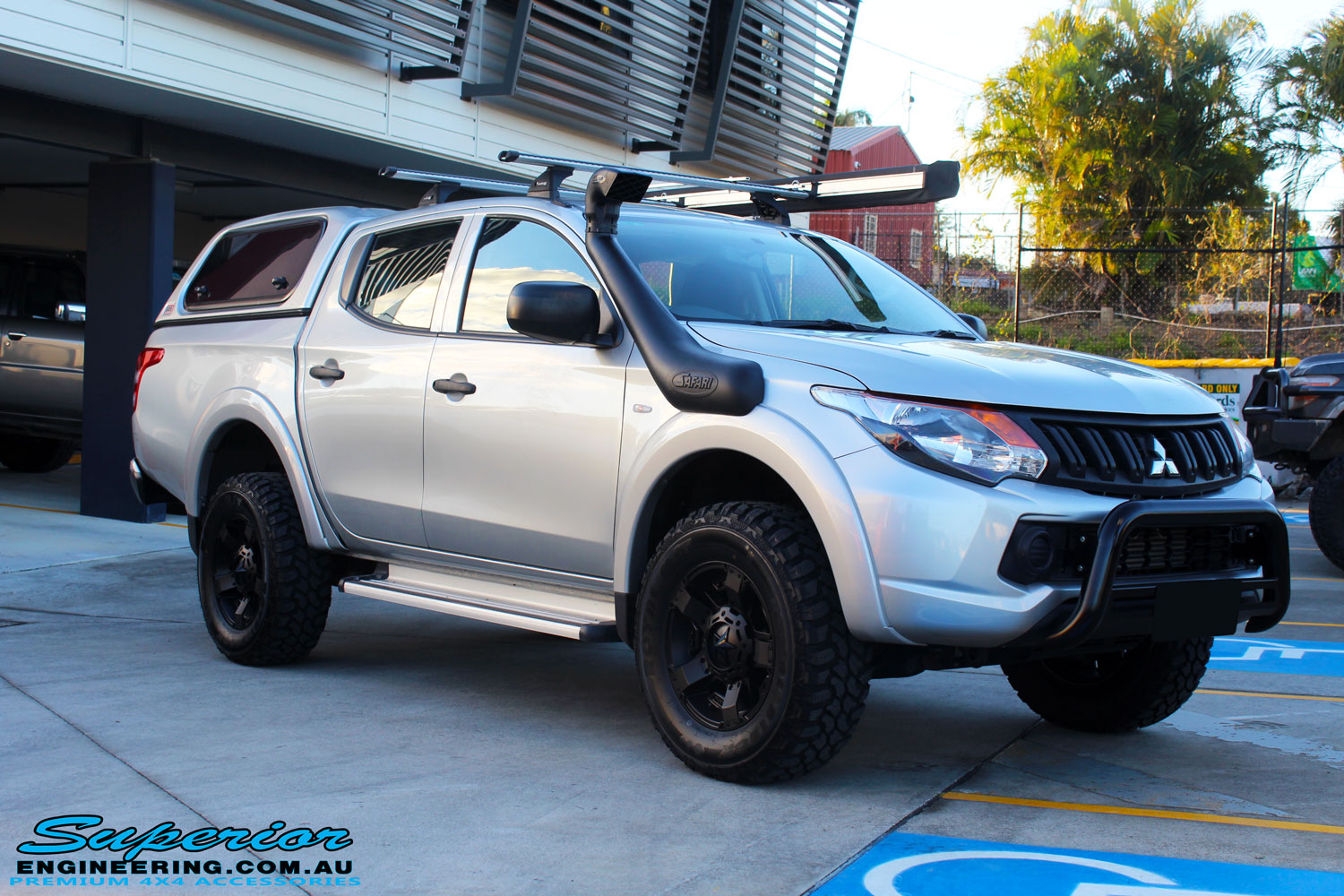 Left front side view of a Mitsubishi MQ Triton in Silver after fitment of a Superior Nitro Gas 30mm Lift Kit