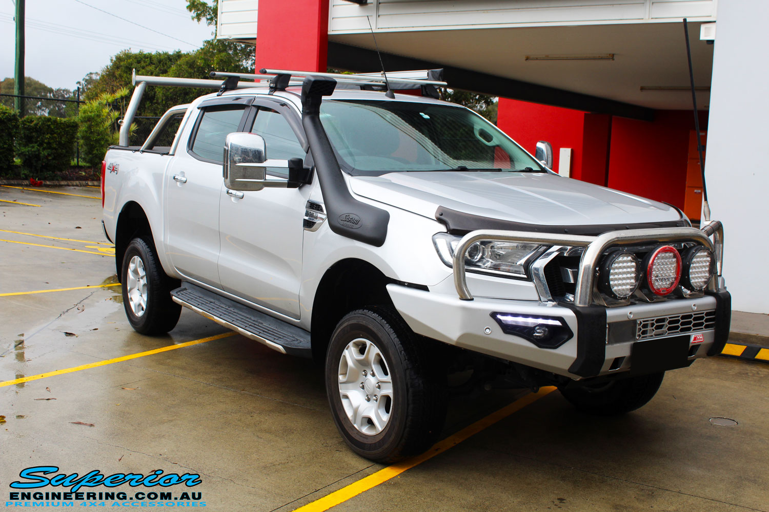 Right front side view of a Ford PXII Ranger in Silver On The Hoist @ Superior Engineering Deception Bay Showroom