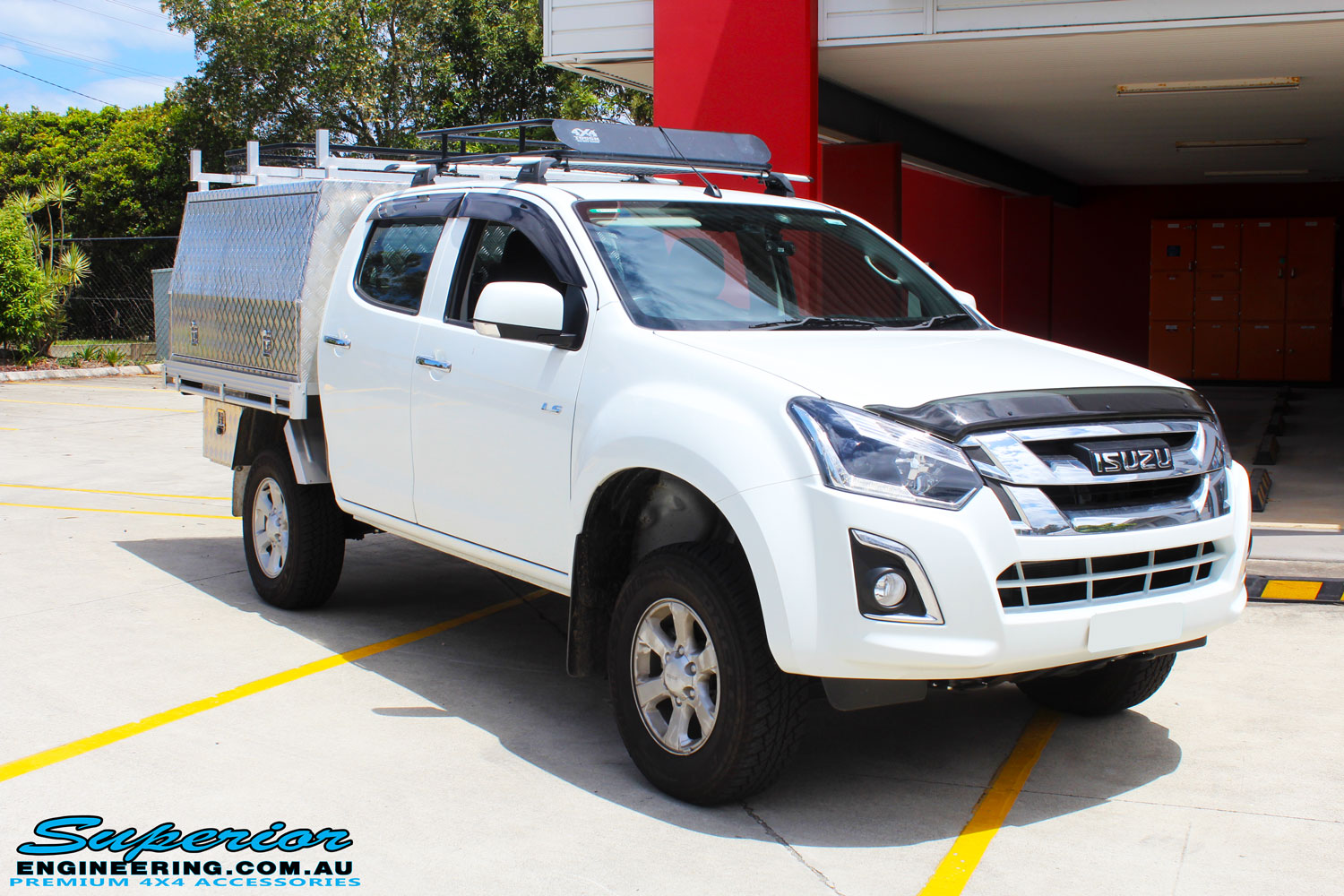 """Right front view of a White Isuzu D-Max Dual Cab after fitment of a Superior Nitro Gas 2"""" Inch Lift Kit"""