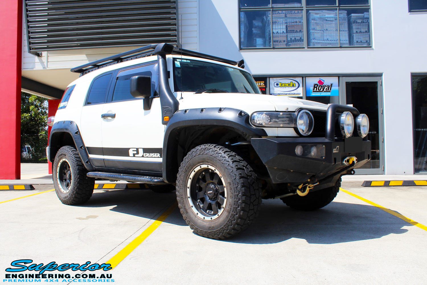 Front right side view of a White Toyota FJ Cruiser after fitment of Superior Chromoly Upper Control Arms