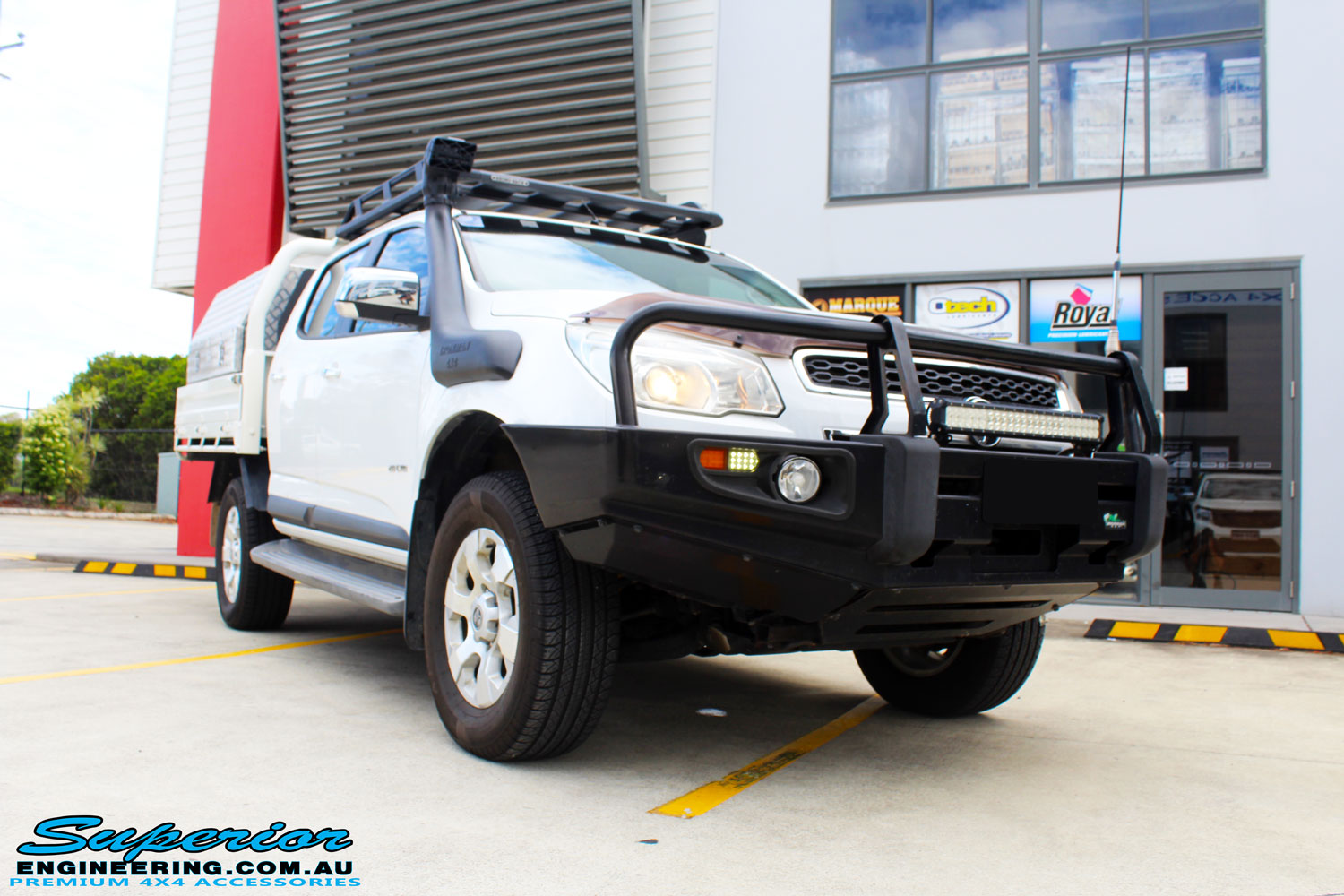 Right front side view of a White Holden Colorado RG after fitment of a Bilstein 45mm Lift Kit with King Coil Springs + Ironman 4x4 Snorkel