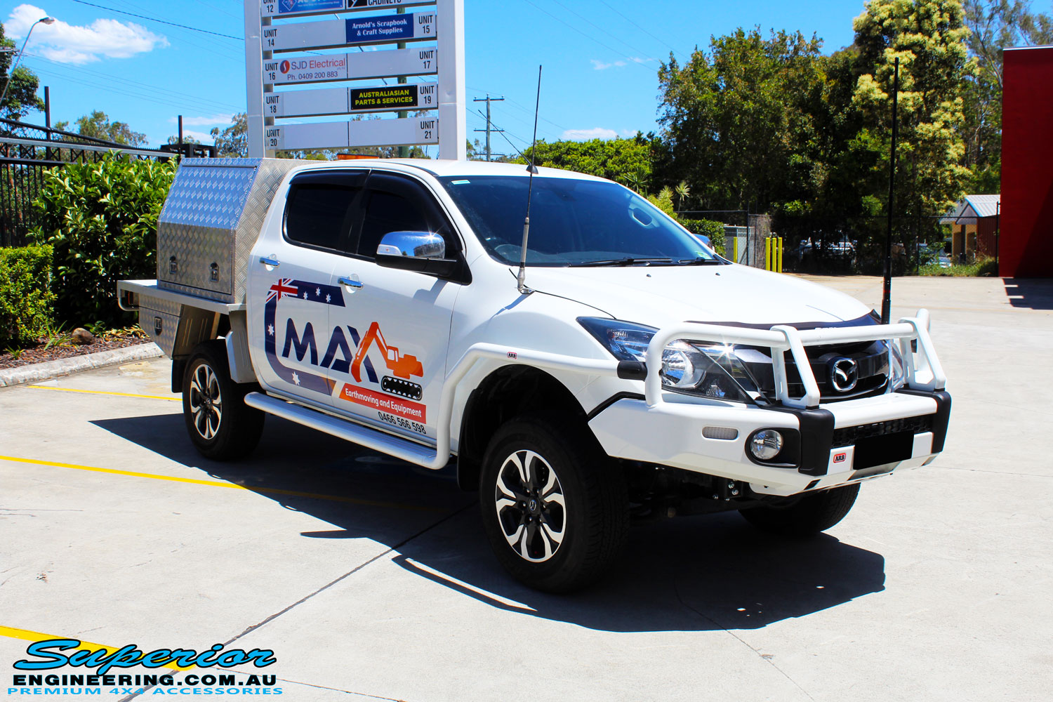 "Right front side view of a White Mazda BT50 Dual Cab after fitment of a Superior 2"" Inch Remote Reservoir Lift Kit"
