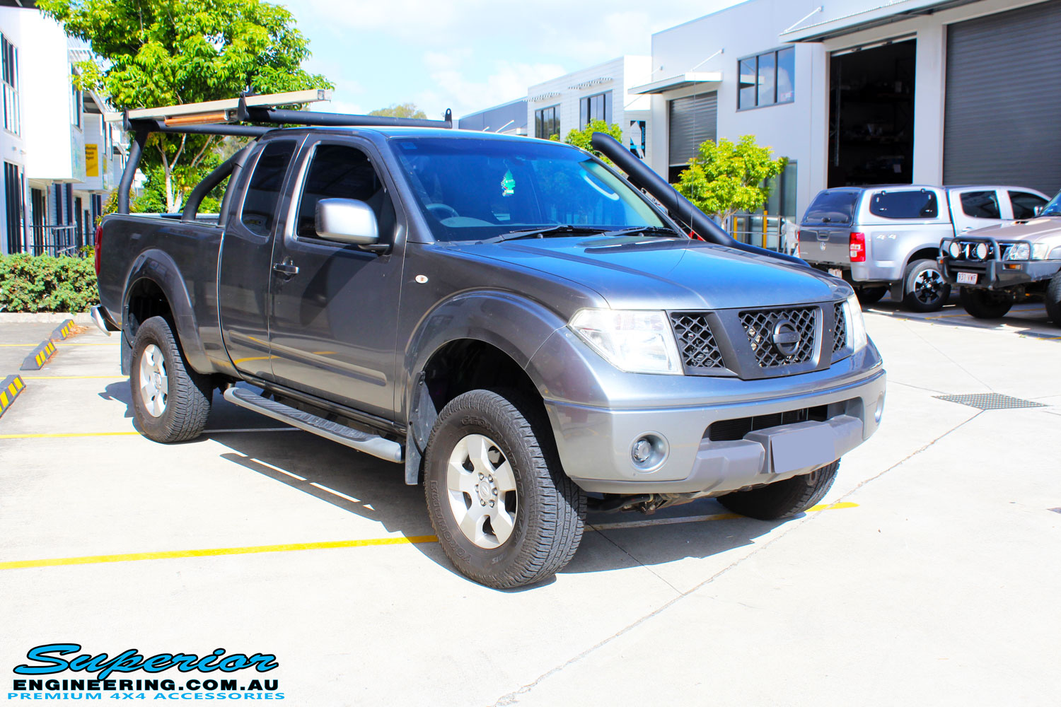 """Right front side view of a Nissan D40 Navara Extra Cab after fitment of a Superior Nitro Gas 2"""" Inch Lift Kit"""