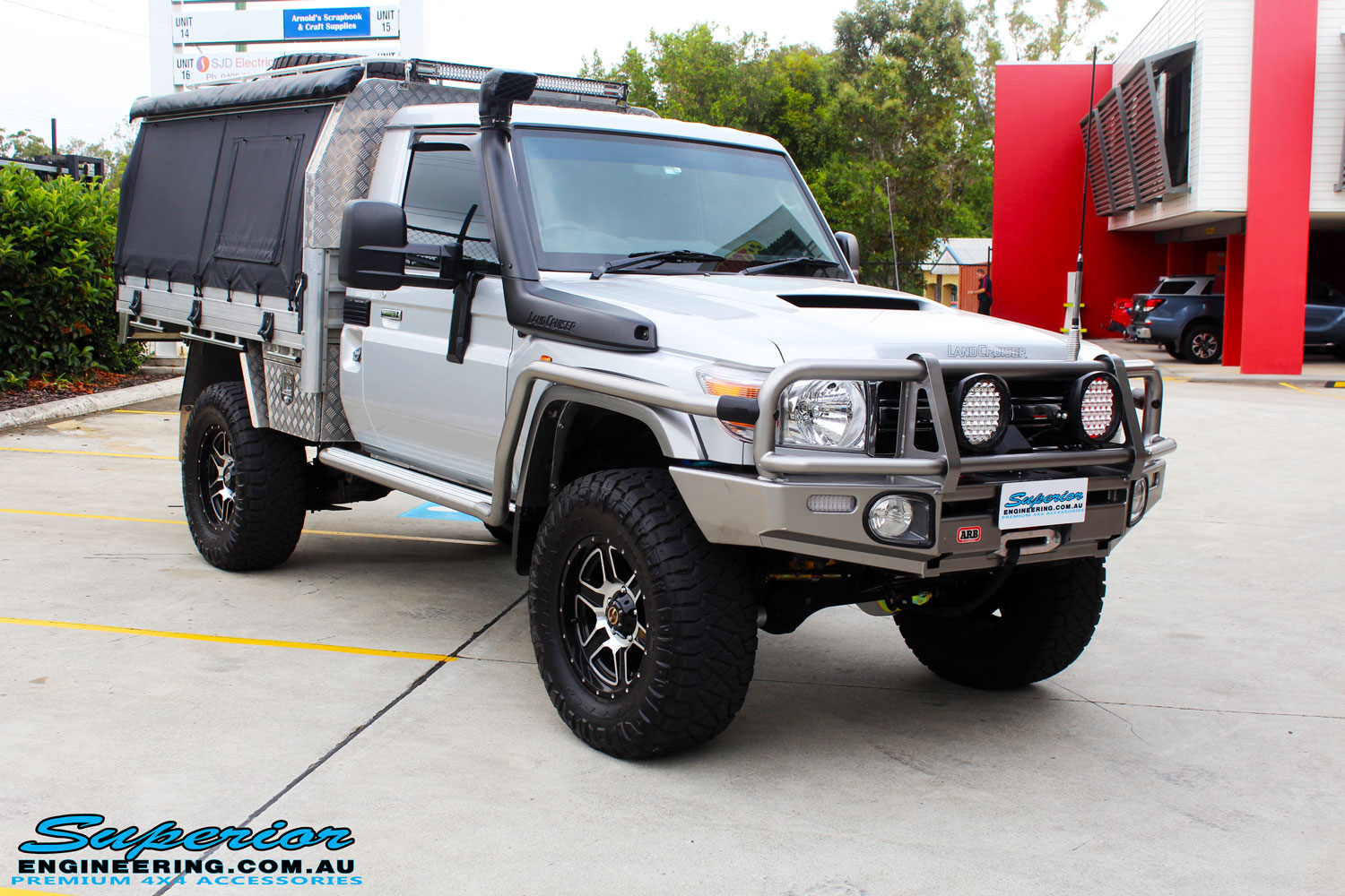 Right front side view of a Toyota 79 Series Landcruiser Single Cab after fitment of a range of Superior and various other brands suspension components