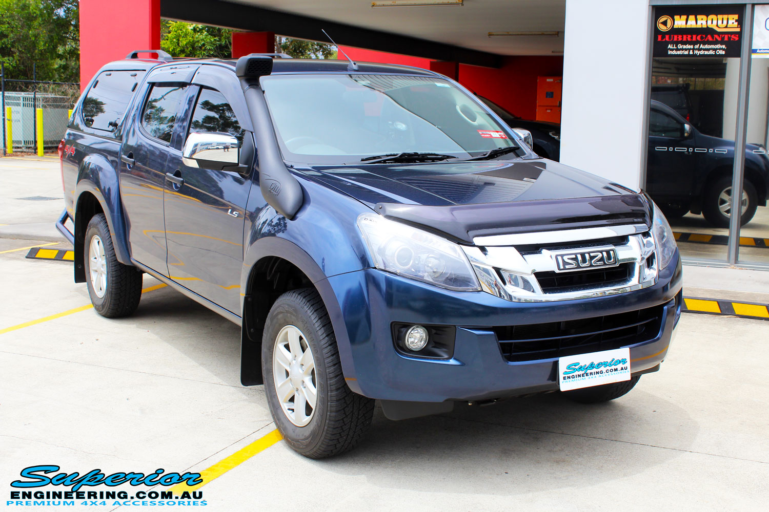 Right front side view of a Isuzu D-Max Dual Cab in Blue ready to be On The Hoist @ Superior being fitted with a Chassis Brace/Repair Plate
