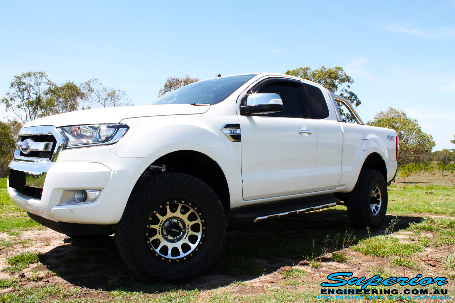 """Front left side view of a White Ford PXII Ranger Dual Cab after fitment of a Superior 2"""" Inch Rear PXII Ranger Coil Conversion Kit with Redarc Dual Battery Setup"""