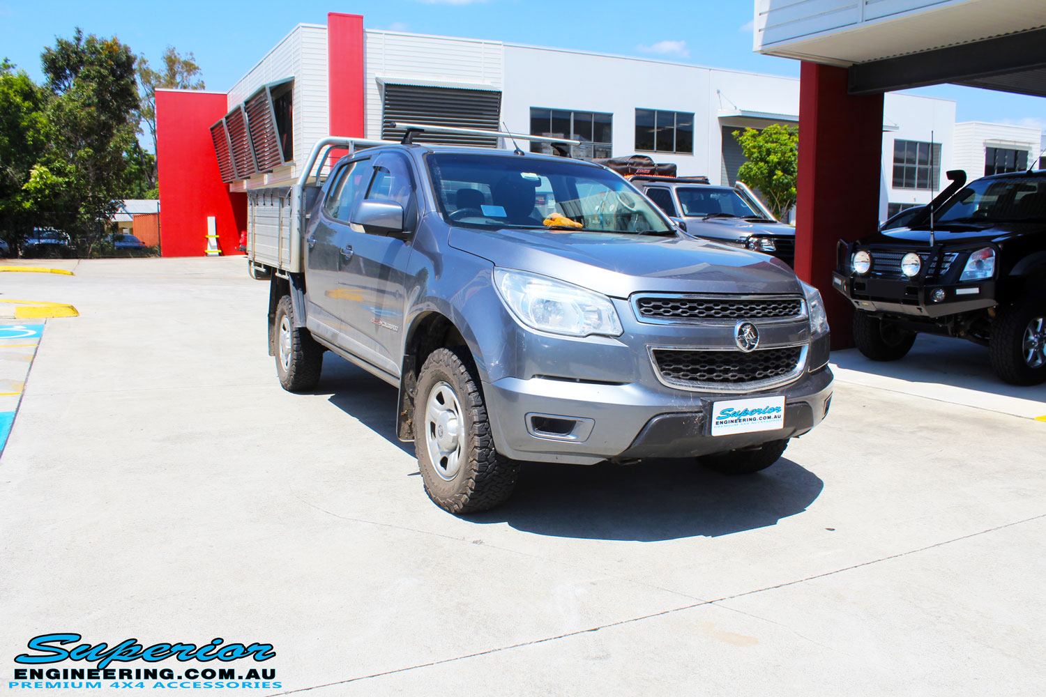 Right front side view of a Holden RG Colorado Dual Cab in Grey ready to be On The Hoist @ Superior being fitted with a Chassis Brace/Repair Plate