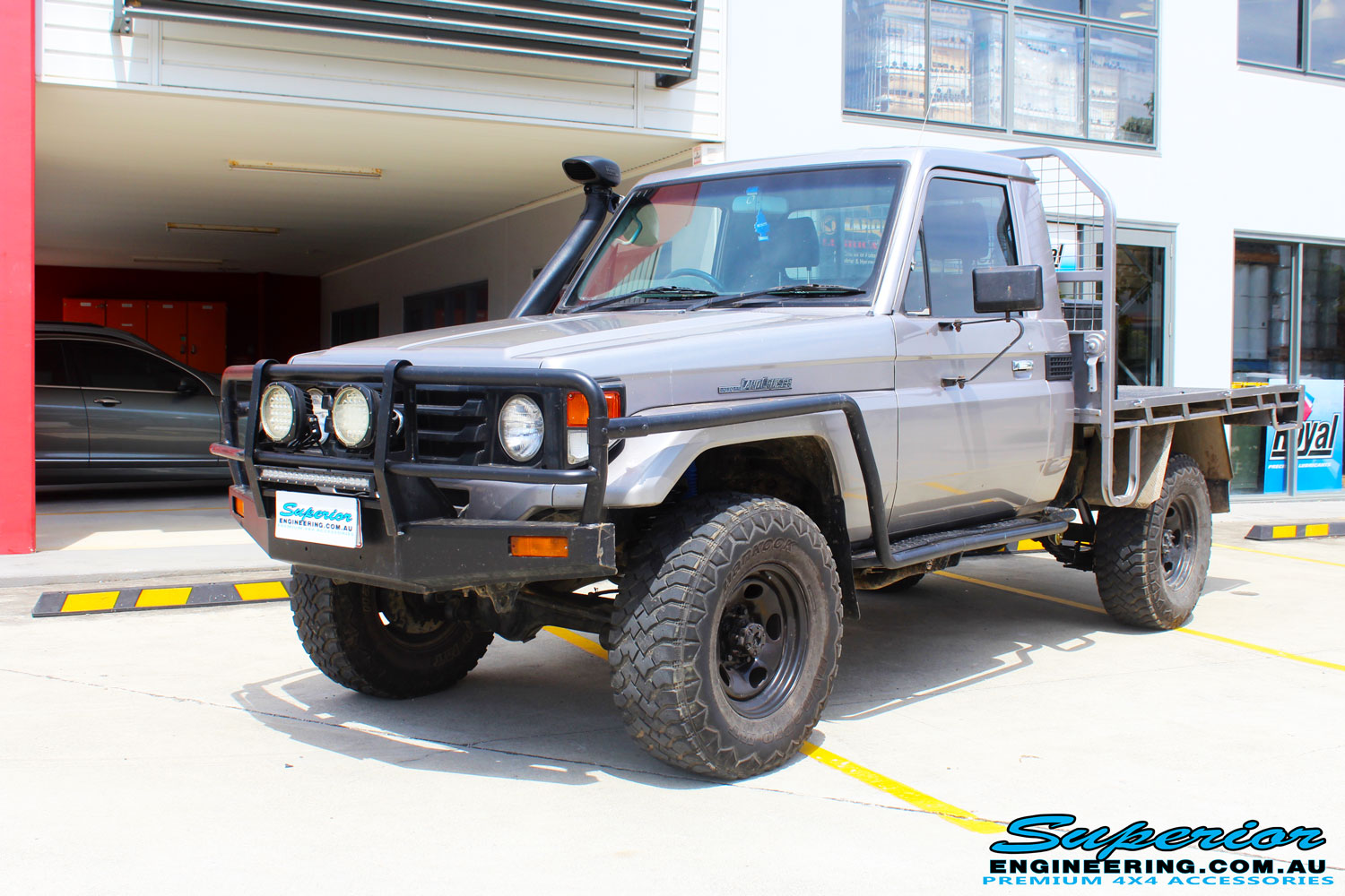 """Left front side view of a Silver Toyota 79 Series Landcruiser after fitment of a Superior Nitro Gas 2"""" Inch Lift Kit"""
