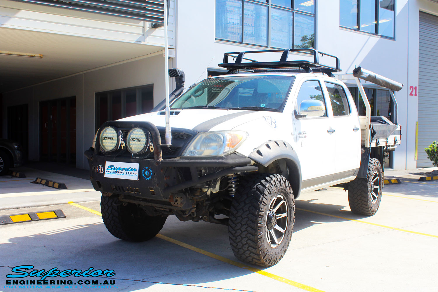 "Left front side view of a Toyota Vigo Hilux Dual Cab after fitment of a Superior Remote Reservoir 3"" Inch Lift Kit with King Coil Springs & Superior Billet Alloy Upper Control Arms"