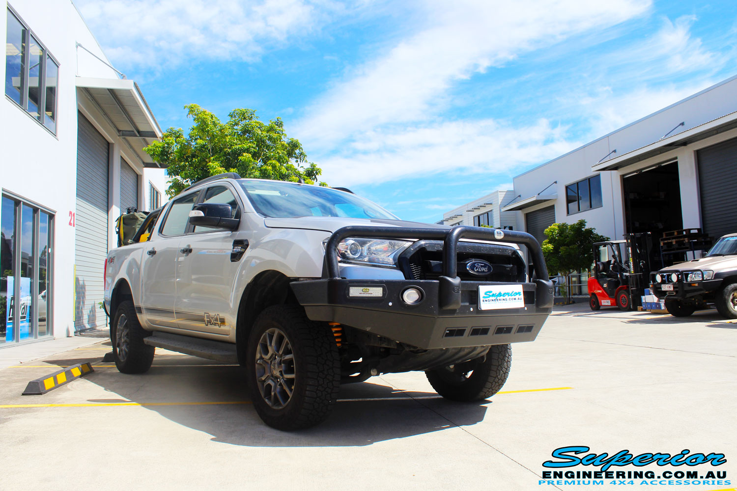 """Right front side view of a Silver Ford PXII Ranger after fitment of a Superior Nitro Gas 2"""" Inch Lift Kit with King Springs & EFS Springs"""