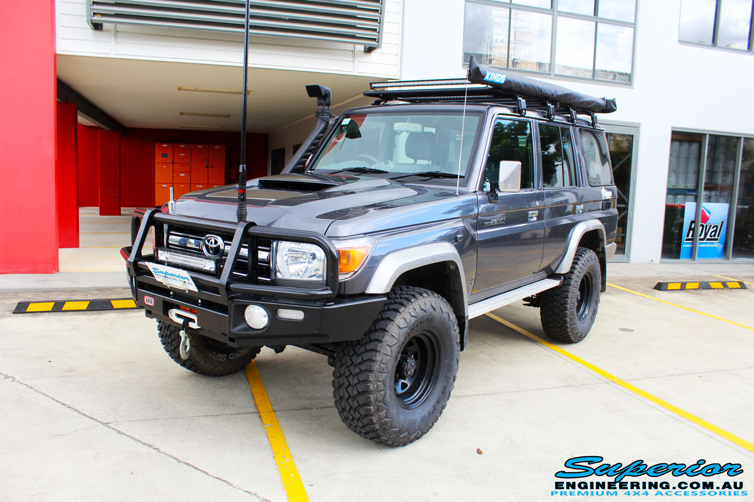"Left front side view of a Toyota 76 Series Landcruiser Wagon in Grey before fitment of a EFS 2"" Lift Kit"