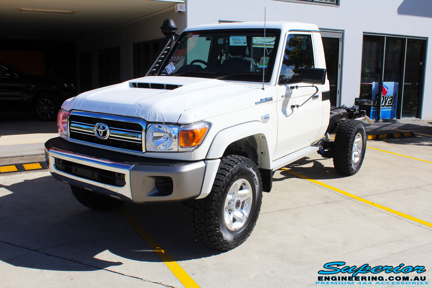 Left front side view of a Toyota Landcruiser 79 Series after fitment of a Lovells GVM Upgrade