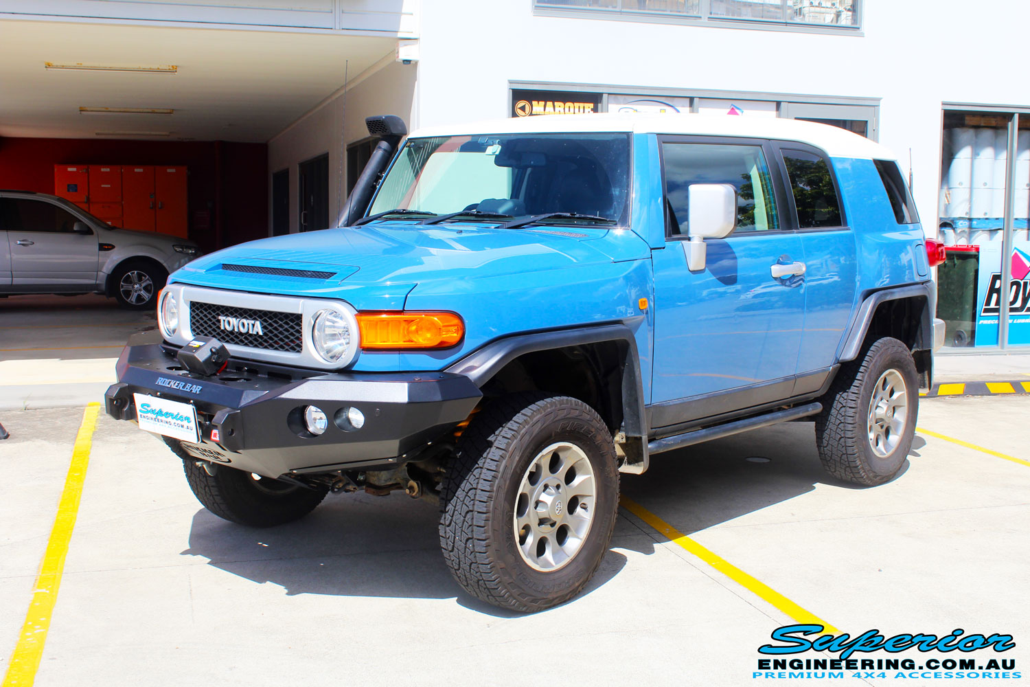 "Left front side view of a Toyota FJ Cruiser in Blue before fitment of a 2"" Inch Lift Kit"
