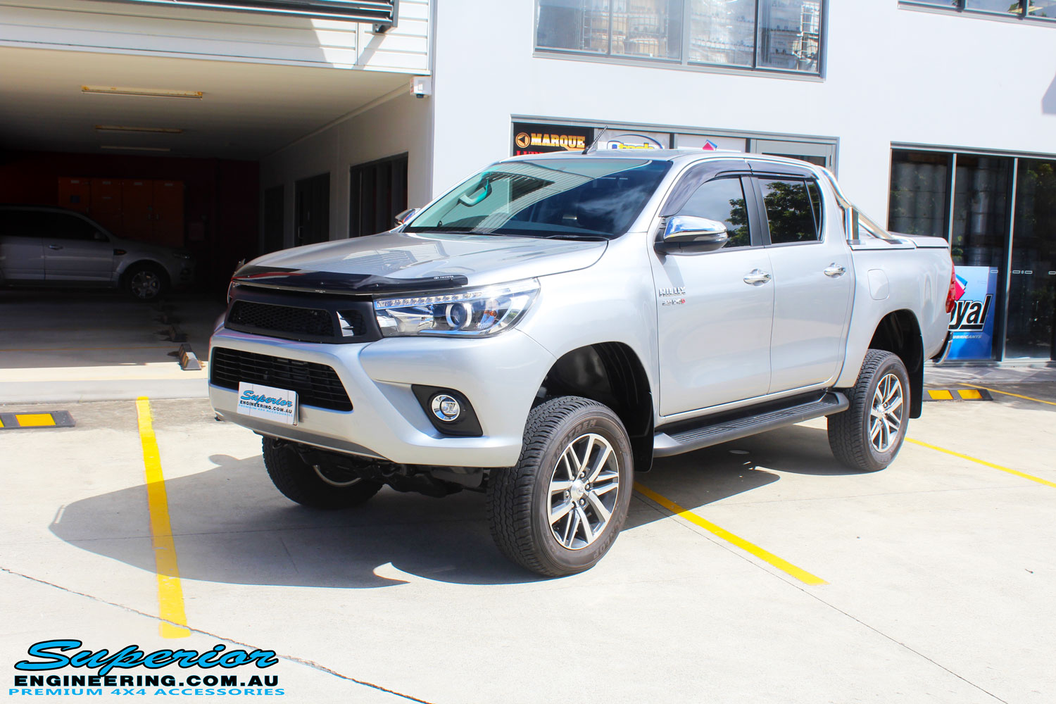 "Left front side view of a Toyota Revo Hilux Dual Cab in Silver after fitment of a 3"" Inch Lift Kit with King Coil Springs, Superior Billet Alloy Upper Control Arms and Body Lift Kit"