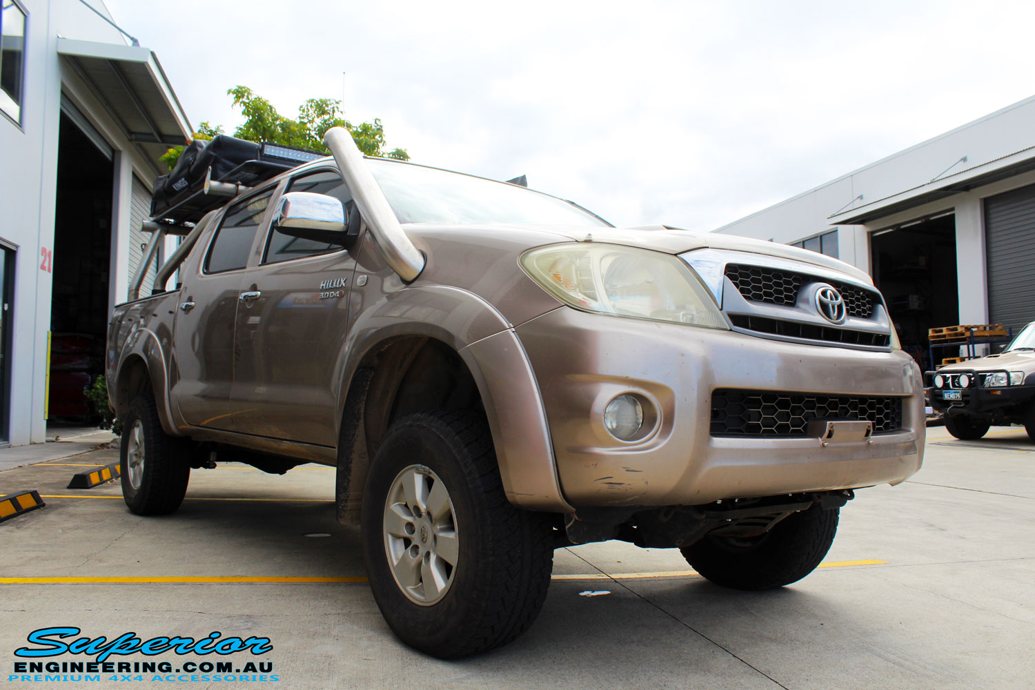 "Right front side view of a Toyota Vigo Hilux Dual Cab after fitment of a Superior Nitro Gas 3"" Inch Lift Kit"